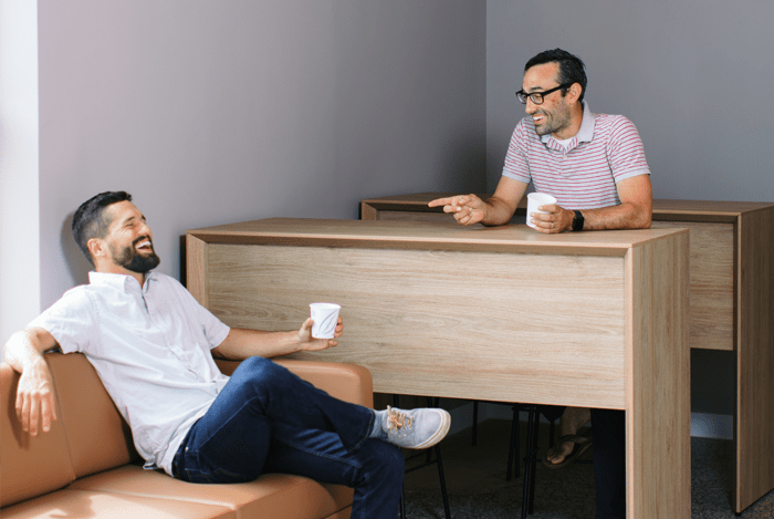 Men talking at coffee bar