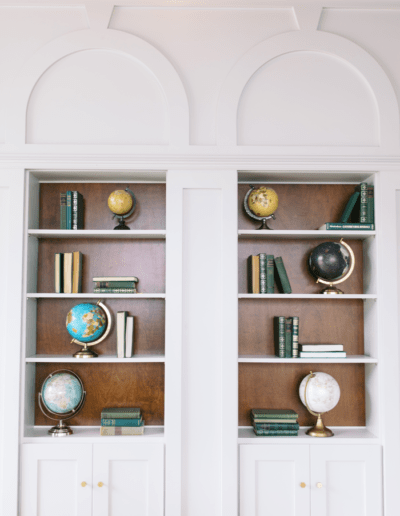 Bookshelf with globes and books on them